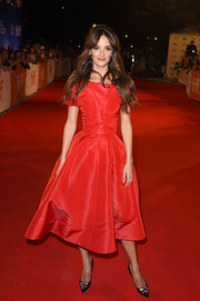 Charlotte Le Bon channeled the glamorous '50s with this short-sleeve red fit-and-flare dress by Dior for the TIFF premiere of 'The Promise.'