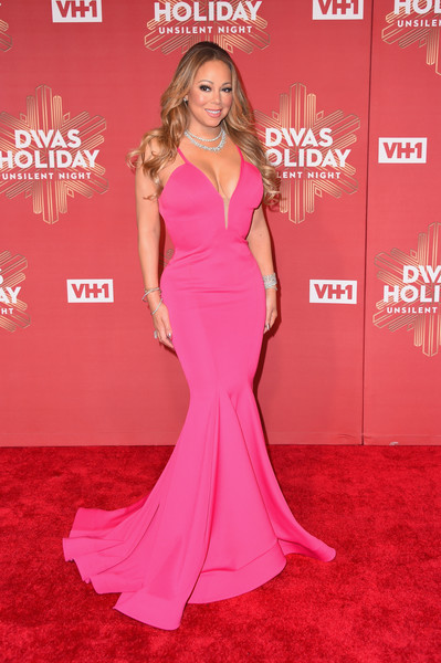Mariah Carey played up her voluptuous figure in a plunging hot-pink mermaid gown by Michael Costello during VH1's Divas Holiday: Unsilent Night.