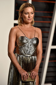 Kate Hudson was in the mood for metallics when she attended the Vanity Fair Oscar party, pairing a gold Oroton clutch with a silver lame gown.