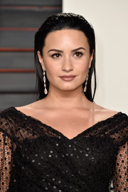 Demi Lovato sported wet-look hair at the Vanity Fair Oscar party.