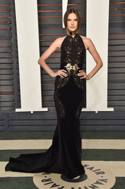 Alessandra Ambrosio put her supermodel physique on display in a black mesh-panel halter gown by Balmain at the Vanity Fair Oscar party.