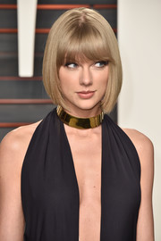 Taylor Swift looked adorable with her bob and eye-grazing bangs at the Vanity Fair Oscar party.