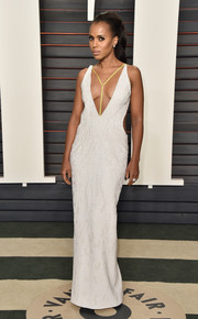Kerry Washington sent pulses racing at the Vanity Fair Oscar party in a textured white Atelier Versace gown with side cutouts and a plunging neckline.