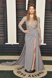 Jessica Biel made a glamorous appearance at the Vanity Fair Oscar party in a gray Zuhair Murad Couture gown with a beaded bodice, a long train, and a thigh-high slit.