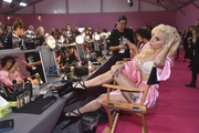 Lady Gaga lounged backstage at the Victoria's Secret fashion show wearing a slinky pink robe, which showed off the unicorn tattoo on her left thigh.