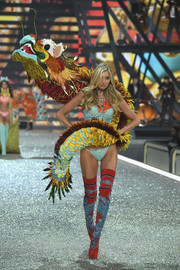 Elsa Hosk shimmied down the Victoria's Secret runway rocking pastel-blue lace lingerie along with a dragon!