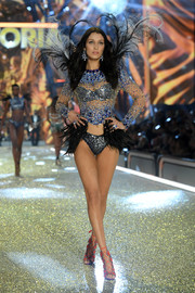 Bella Hadid walked the Victoria's Secret runway wearing a sheer, embellished top over a silver bra.