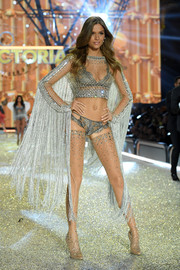 Josephine Skriver teamed her sheer top with silver lace lingerie.