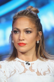 Jennifer Lopez finished off her beauty look with a glossy red-orange lip.