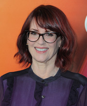 Megan Mullally wore a cute wavy 'do with side-swept bangs at the NBCUniversal Press Tour.