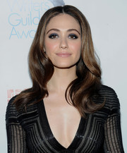 Emmy Rossum contrasted her bold eye makeup with pale pink lipstick.