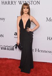 Kristina Bazan cut a sultry figure at the amfAR New York Gala in a black House of CB gown with a navel-grazing neckline.