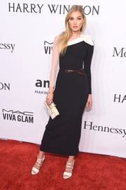 Elsa Hosk paired her dress with strappy white sandals.