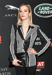 Sylvia Hoeks arrived for the 2017 AMD British Academy Britannia Awards carrying a simple black leather clutch.