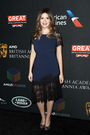 Carly Steel attended the 2017 AMD British Academy Britannia Awards wearing a navy dress with a black lace hem and sleeves.