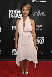 Regina Hall looked ravishing in a pale pink halter dress with a down-to-there neckline at the 2017 American Black Film Festival.
