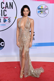 Jenna Dewan-Tatum turned heads in a slinky gold halter gown by Julien Macdonald at the 2017 American Music Awards.