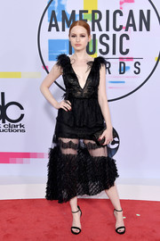 Madelaine Petsch looked coquettish in a plunging, sheer-bottom LBD by Fabiana Milazzo at the 2017 American Music Awards.