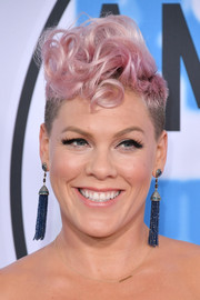 Pink added a dose of glamour with a pair of blue tassel earrings by Narcisa Pheres.