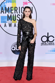 Maia Mitchell looked fierce at the 2017 American Music Awards in an Alberto Audenino one-sleeve jumpsuit rendered entirely in petal appliques.