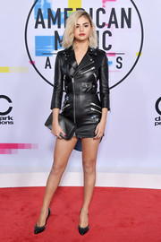 Selena Gomez opted for a moto-chic leather dress by Coach when she attended the 2017 American Music Awards.