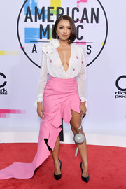 Kat Graham took a bold plunge with this deep-V white blouse by Ronald van der Kemp Couture at the 2017 American Music Awards.