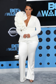 Dascha Polanco was hard to miss in a plunging white Bishme R. Cromartie pantsuit with a massive rosette accent at the 2017 BET Awards.