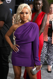 Karrueche Tran teamed a silver clutch with a purple one-shoulder dress for the 2017 BET Awards.