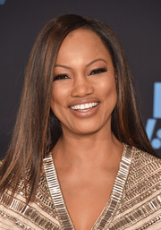 Garcelle Beauvais wore her hair sleek straight with a side part at the 2017 BET Awards.