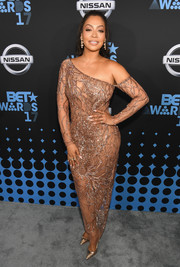 La La Anthony turned up the heat in a sheer nude off-one-shoulder gown by Thai Nguyen Atelier at the 2017 BET Awards.