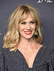 January Jones swiped on some red lipstick for a pop of color to her monochrome outfit.