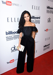 Jhene Aiko punctuated her black outfit with a white hand-strap clutch by Dior.