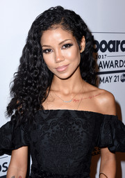 Jhene Aiko wore her hair down in voluminous, tight curls at the Women in Music event.