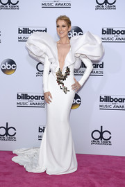Celine Dion stole the spotlight in a white Stephane Rolland Couture gown with sculptural shoulders and a long train at the 2017 Billboard Music Awards.