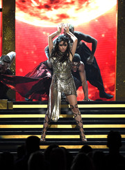 Camila Cabello completed her fierce look with thigh-high gladiator heels by Schutz.