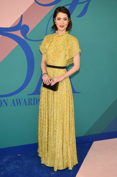 Mary Elizabeth Winstead looked festive in a tinsel-embellished yellow gown by Lela Rose at the 2017 CFDA Fashion Awards.