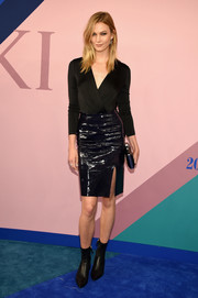 Karlie Kloss gave her look an edgy punch with a black patent pencil skirt, also by Diane von Furstenberg.