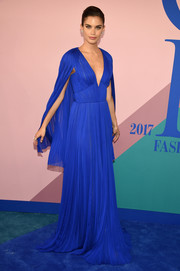 Sara Sampaio made a regal entrance in a caped blue J. Mendel gown at the 2017 CFDA Fashion Awards.