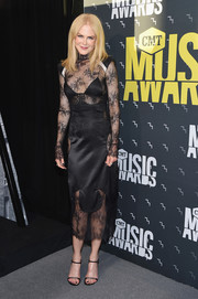 Nicole Kidman was goth-glam in a black lace-panel dress by Off-White at the 2017 CMT Music Awards.