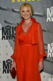 Katherine Heigl paired a red Edie Parker box clutch with a matching gown for the 2017 CMT Music Awards.