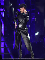 Lady Gaga teamed her coat with black lace-up boots by Christian Louboutin.