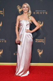 Julianne Hough perfected her look with a plum velvet tube clutch by Jimmy Choo.
