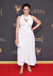 Rachel Bloom flashed her cleavage in a ruffled white cutout dress at the 2017 Creative Arts Emmy Awards.