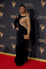 Laverne Cox was all about sultry glamour at the 2017 Creative Arts Emmy Awards in a black and gold Mikael D gown with a sheer, beaded panel and a slashed shoulder.