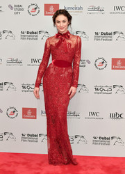 Olga Kurylenko was a stunner in a fitted red lace gown by Elie Saab Couture at the 2017 Dubai International Film Festival opening night gala.