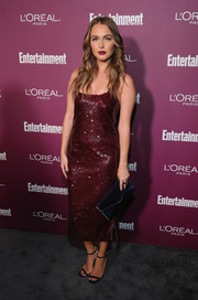 Camilla Luddington styled her look with a navy envelope clutch by Rebecca Minkoff.