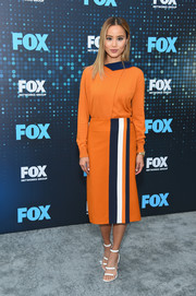 Jamie Chung coordinated her top with an orange, navy, and white pencil skirt, also by Victoria Victoria Beckham.