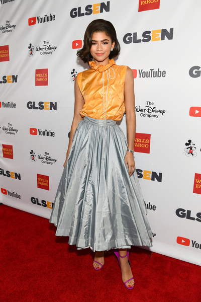 Zendaya Coleman looked cute and sweet in an orange ruffle-neck top by Calvin Klein at the 2017 GLSEN Respect Awards.