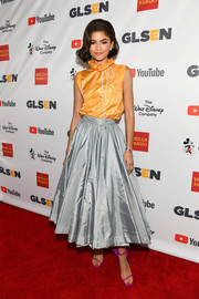 Zendaya Coleman completed her colorful ensemble with a pair of winged purple sandals by Calvin Klein.