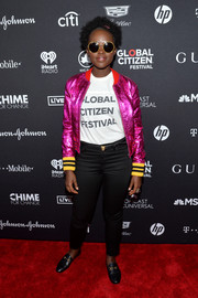 Lupita Nyong'o dressed up her Global Citizen Festival tee with a metallic pink bomber jacket by Gucci.